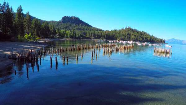 An aerial shot over old pier pilings in Glenbrook, Lake Tahoe, Nevada. Royalty-free stock video