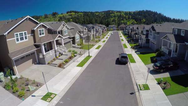 An aerial image over a typical american suburban street. Royalty-free stock video