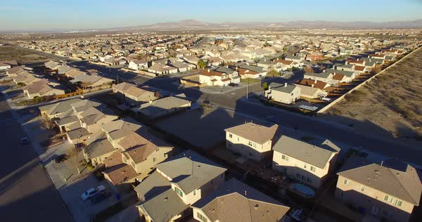Aerial over vast desert housing tracts suggests suburban sprawl. Royalty-free stock video