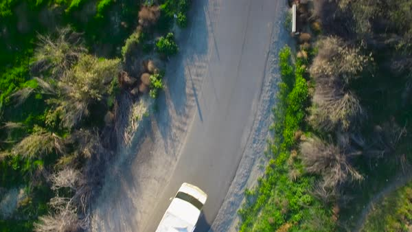 Aerial directly above a motorhome traveling on a country road. Royalty-free stock video