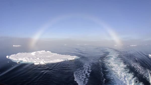 Fog bow over the sea ice from the stern of the ship at 80 degrees north in Svalbard, Norway.   Fog bow over the sea ice from the stern of the ship at 80 degrees north in Svalbard, Norway. Royalty-free stock video
