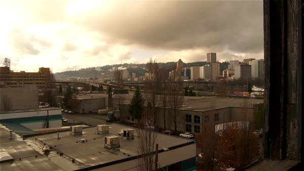 Time lapse of the Portland Oregon skyline from a window.. Royalty-free stock video