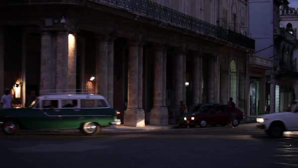 Old cars drive on the streets of Havana, Cuba at night. Royalty-free stock video