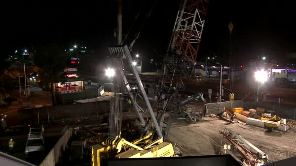 Construction workers work on a freeway overpass in time lapse at night in Los Angeles. Royalty-free stock video