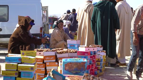 Moroccan men sit beside the road selling goods. Royalty-free stock video