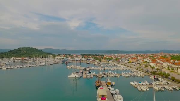Rising aerial over a coastal fishing village in Croatia. Royalty-free stock video