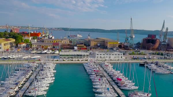 Aerial over a coastal fishing village in Croatia. Royalty-free stock video