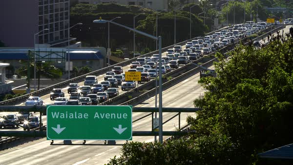 Daily morning westbound traffic from Hawaii Kai lines up on the H-1 Freeway in Honolulu, Hawaii Royalty-free stock video
