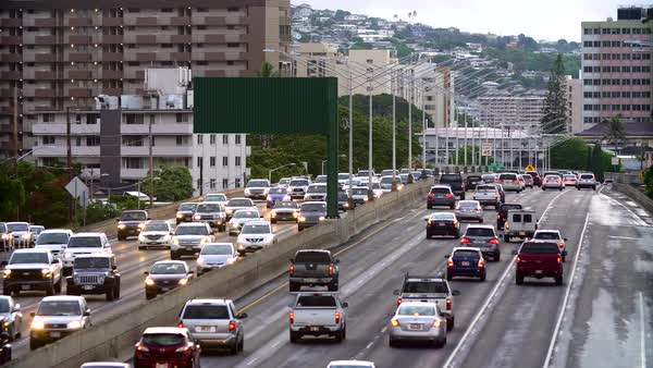Cars moving along on the H-1 Freeway in Honolulu, Hawaii Royalty-free stock video