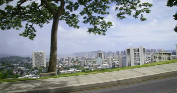 Downtown Honolulu, Hawaii is seen from a passing vehicle. Royalty-free stock video