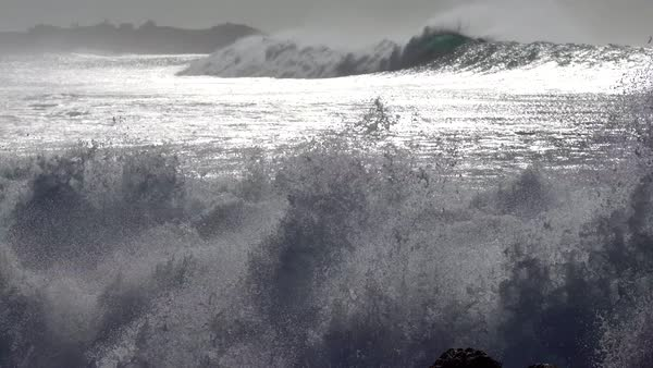 Blue waves roll into the coast of Hawaii. Royalty-free stock video