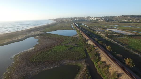 High aerial over the California coastline, train and highway near San Diego. Royalty-free stock video