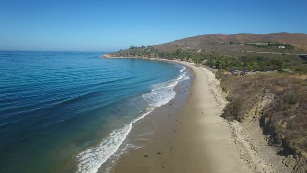 A beautiful long aerial shot along Refugio State Beach near Santa Barbara California. Royalty-free stock video