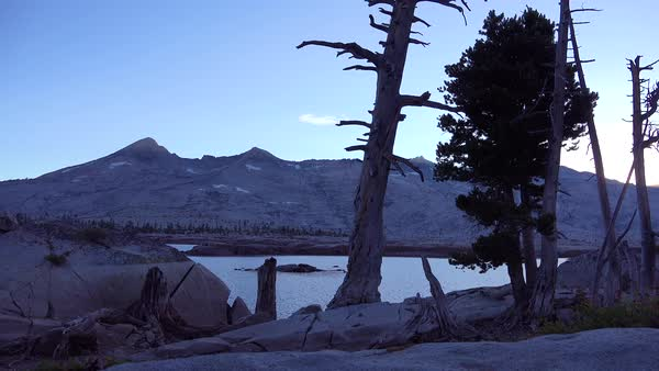 The sun rises in timelapse in the Desolation Wilderness of the Sierra Nevada mountains. Royalty-free stock video