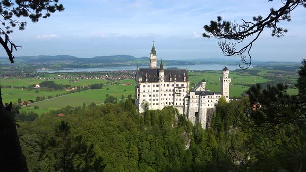 A classic view through the trees of Neuschwanstein Mad Ludwigs castle in Bavaria, Germany. Royalty-free stock video