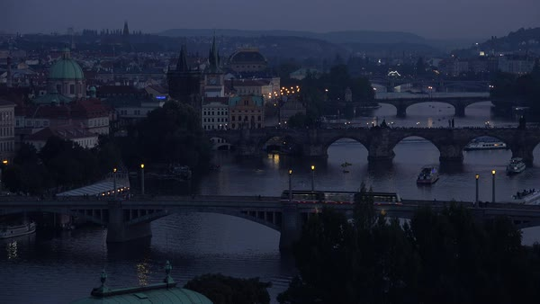 Beautiful night establishing shot of boats along the Vltava River in Prague, Czech Republic. Royalty-free stock video