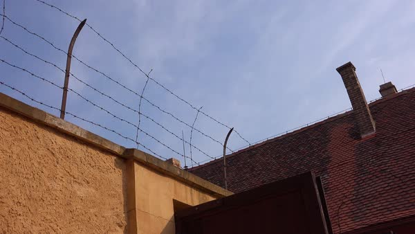 Barbed wire atop high walls at the Terezin Nazi concentration camp in Czech Republic. Royalty-free stock video
