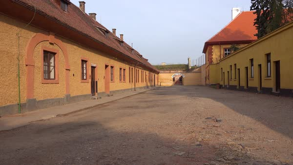 Long rows of buildings housed prisoners at the Terezin Nazi concentration camp in Czech Republic. Royalty-free stock video
