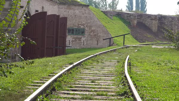 Railroad track near crematorium and ovens at the Terezin Nazi concentration camp in Czech Republic. Royalty-free stock video