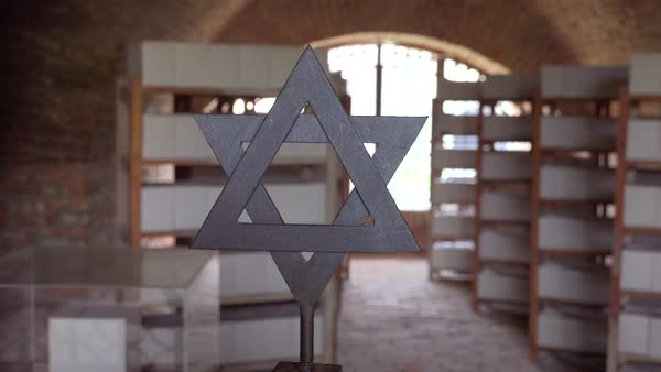 A Jewish star of David near urns of ashes in the crematorium at the Terezin Nazi concentration camp in Czech Republic. Royalty-free stock video