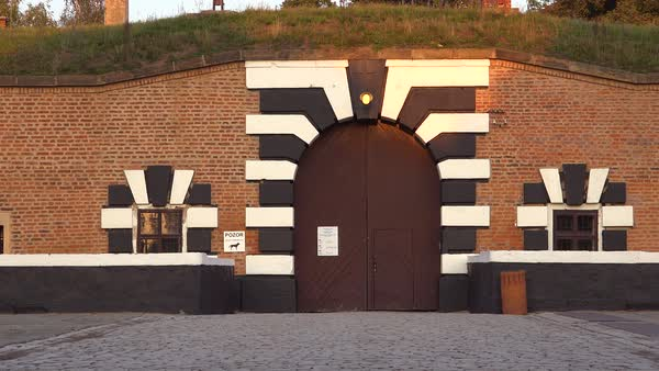 Striped entrance gates at the Terezin Nazi concentration camp in Czech Republic. Royalty-free stock video