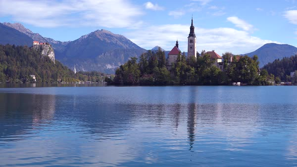 Beautiful establishing shot of Lake Bled and island castle, Slovenia. Royalty-free stock video