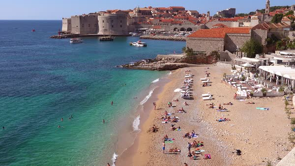 View over the bay and busy beach in the old city of Dubrovnik, Croatia. Royalty-free stock video