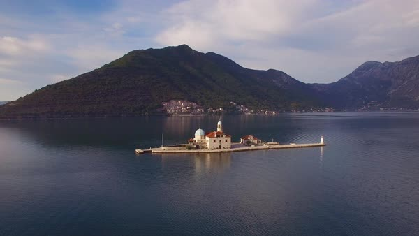 Beautiful aerial over the Our Lady rock island church in Boka Bay, Montenegro. Royalty-free stock video