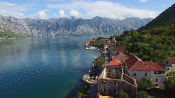 Stunning aerial of an attractive village on the shores of Boka Bay, Montenegro. Royalty-free stock video