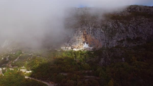 Beautiful approaching aerial through clouds of the Ostrog monastery in Montenegro. Royalty-free stock video