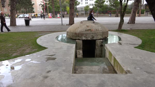 Concrete pillbox bunkers are found in downtown Tirana Albania. Royalty-free stock video