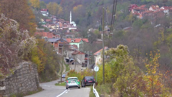 Establishing shot of a small village in Kosovo with mosque. Royalty-free stock video