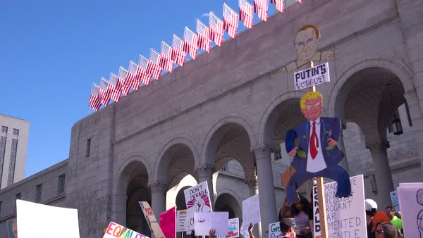 A huge protest against the presidency of Donald Trump in downtown Los Angeles identifies the President as a puppet of Putin. Royalty-free stock video