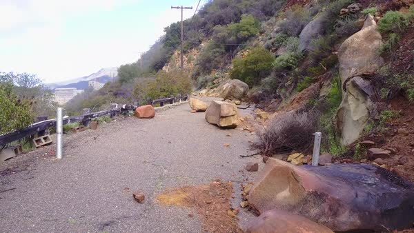 A landslide with large boulders blocks a road. Royalty-free stock video