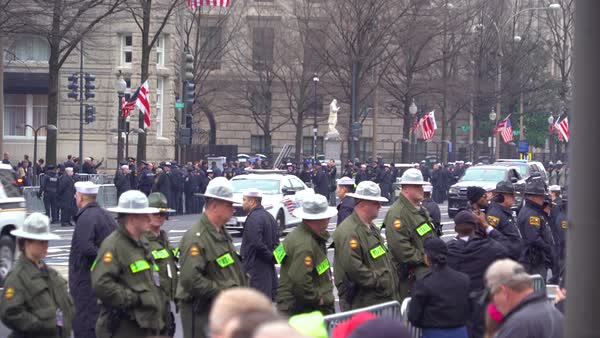 Donald Trump's presidential motorcade moves through Washington DC during the Inauguration. Royalty-free stock video