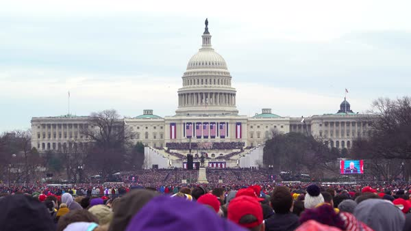 Crowds watch Donald Trump's inauguration as president of the United States. Royalty-free stock video