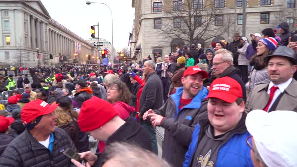 Trump supporting crowds watch the Presidential motorcade at the Inauguration in Washington D.C. Royalty-free stock video