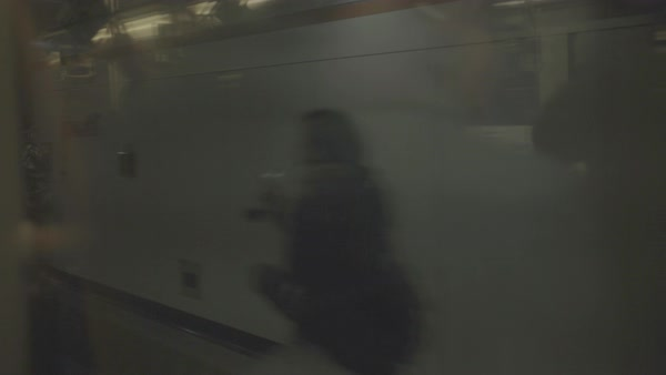 Hand-held shot of a subway train leaving a station Royalty-free stock video