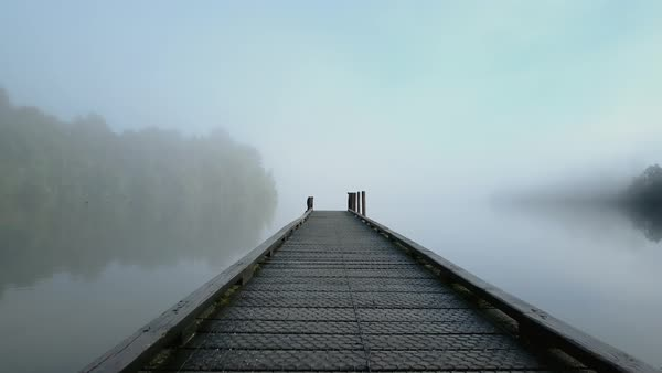 Drone shot of a jetty on a misty lake Royalty-free stock video