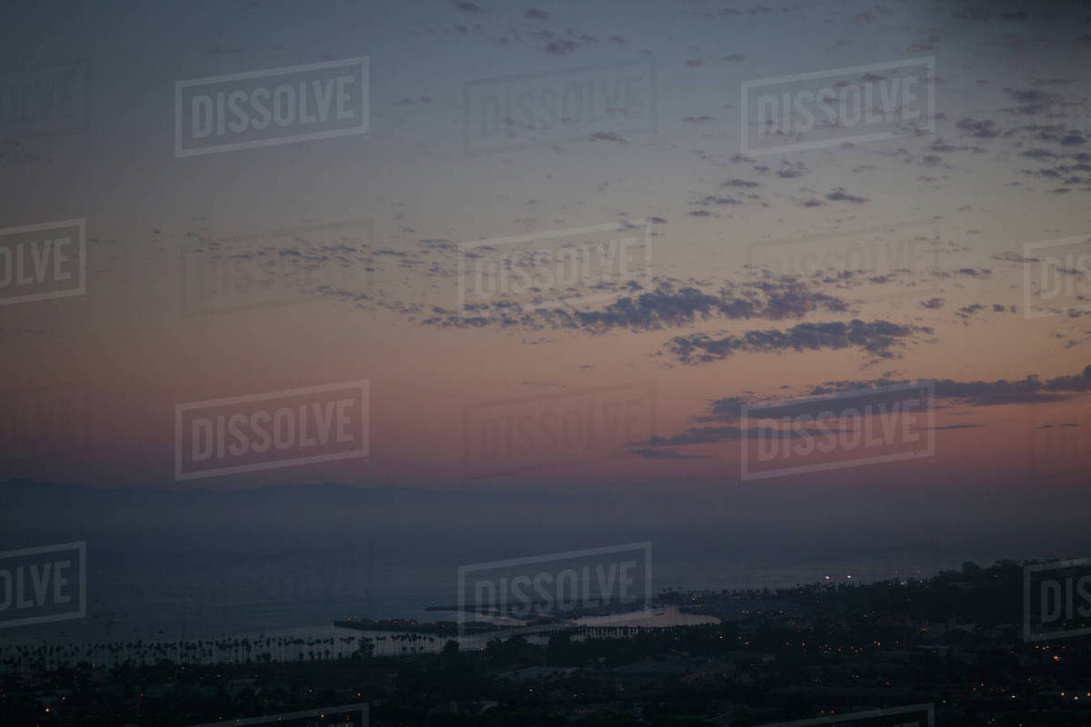 View of city near ocean at sunset Royalty-free stock photo
