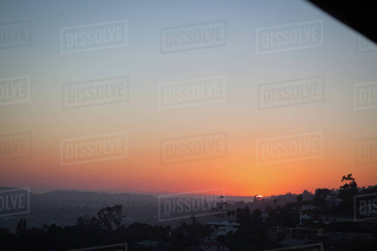 View of sun setting behind the hills Royalty-free stock photo