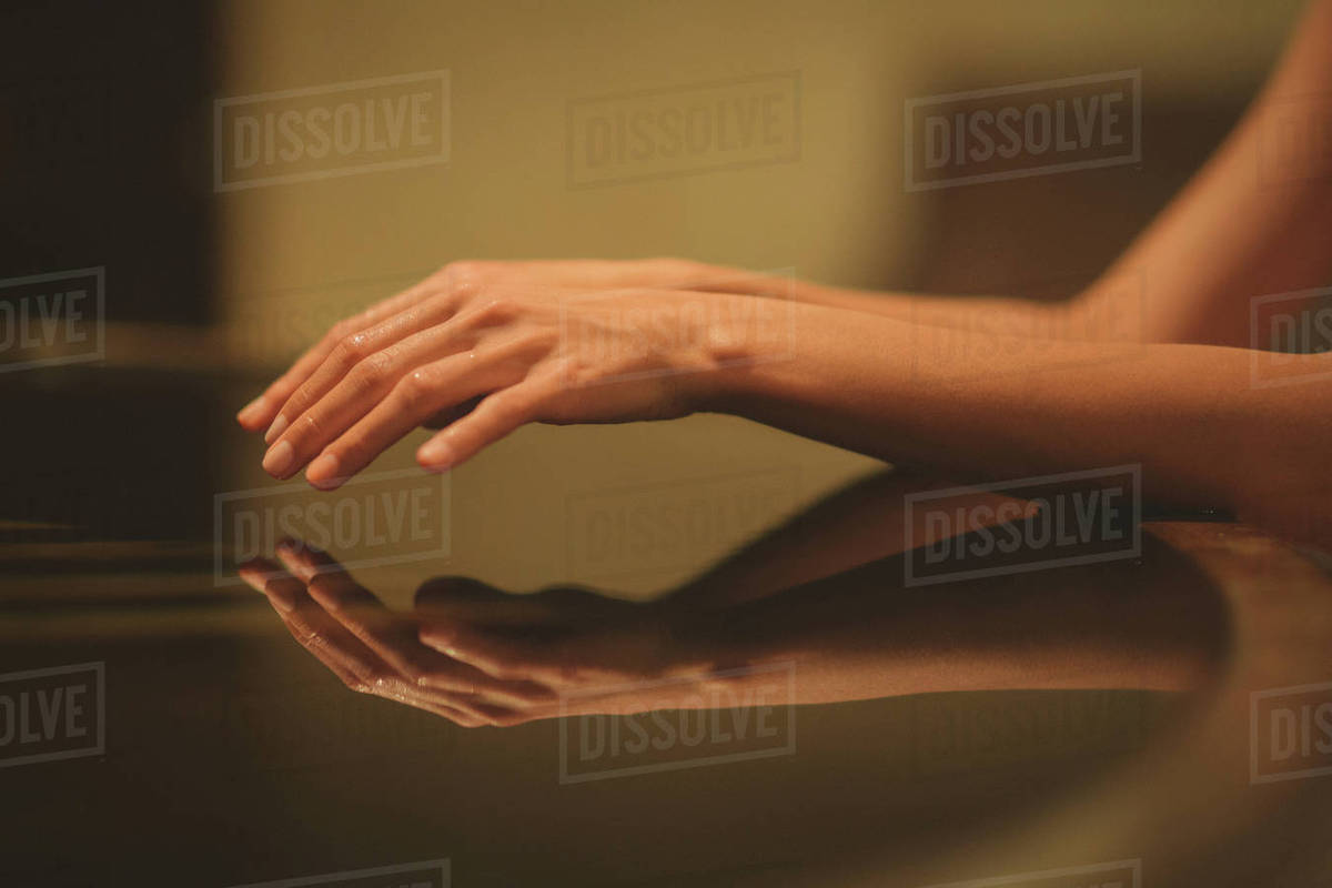 Reflection of woman's wet hands on glass Royalty-free stock photo