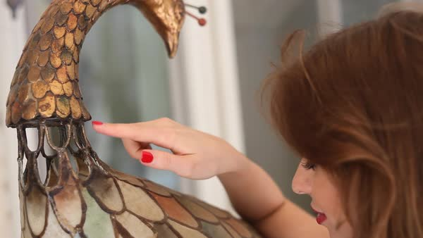Close-up shot of woman caressing bird art statue Royalty-free stock video