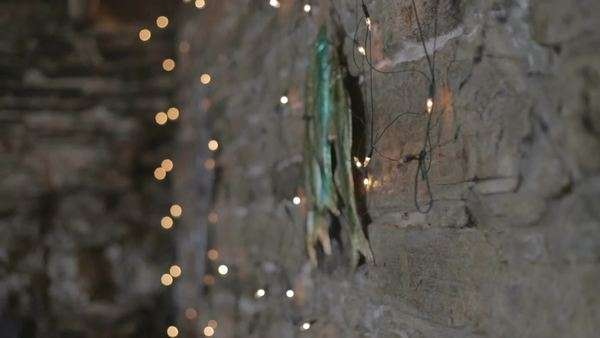 Fairy lights against brick rustic wall Royalty-free stock video