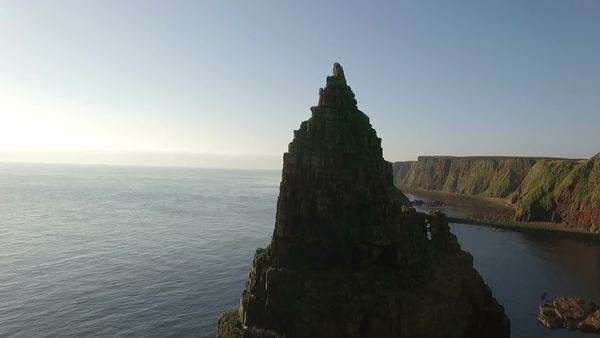 Drone shot of dramatic sea stacks at Duncansby Head near John O' Groats in Scotland Royalty-free stock video