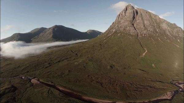 Wide aerial shot of buachaille etive mor mountain in the Scottish highlands with cloud inversion Royalty-free stock video