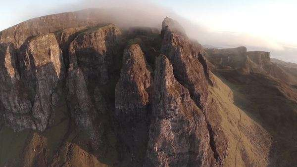 Aerial shot of the Quairang in Skye (Scotland) with morning light revealing dramatic landscape of the Needle Royalty-free stock video