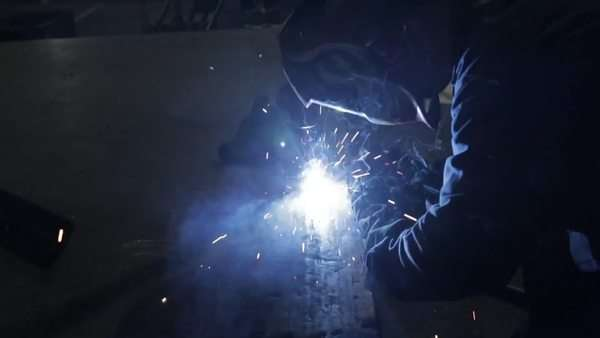 Man using welding in a metal fabricating workshop Royalty-free stock video