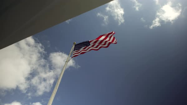 Low-angle shot of an American flag flapping in wind Royalty-free stock video