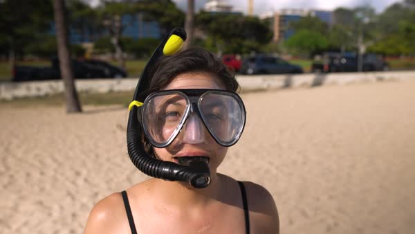 Hand-held shot of a woman wearing diving goggles Royalty-free stock video